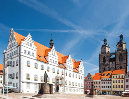 Market square in Wittenberg, main square of old german town. Monuments of Martin Luther and Philipp Melanchthon. Wittenberg is Luther City in Germany