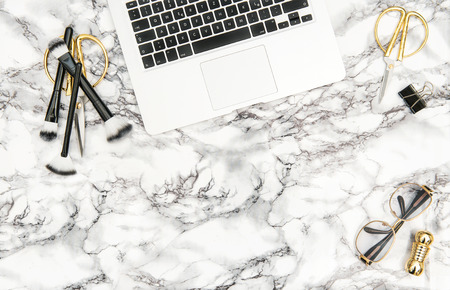 Notebook, supplies, feminine accessories on bright marble office desk background. Fashion flat lay for blogger social media Standard-Bild