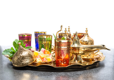 Arabic tea coffee service with golden cups and lantern. Ramadan kareem. Holidays decoration