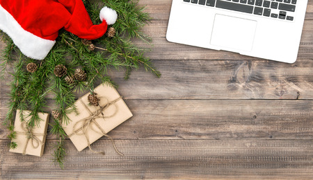 Office desk with Christmas decoration and gifts