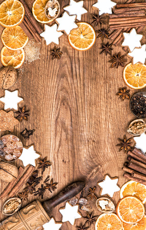Christmas food, cookies and spices. Flat lay on wooden background Stock Photo