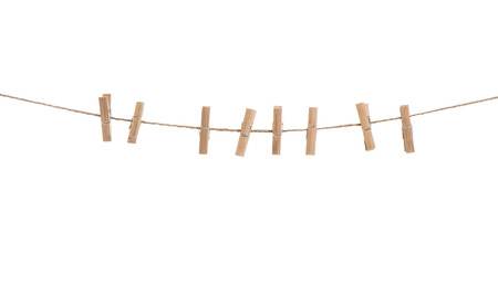 Clothes line with pegs isolated over white background. Clothespins on rope