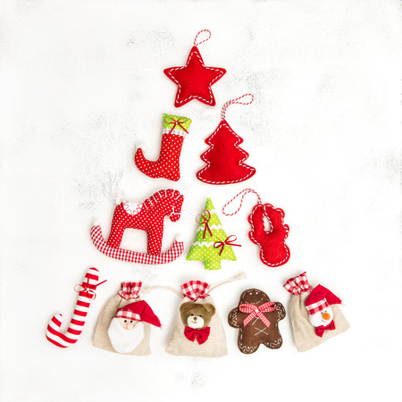 Christmas tree ecoration and gift bags. Holidays background on white Stock Photo
