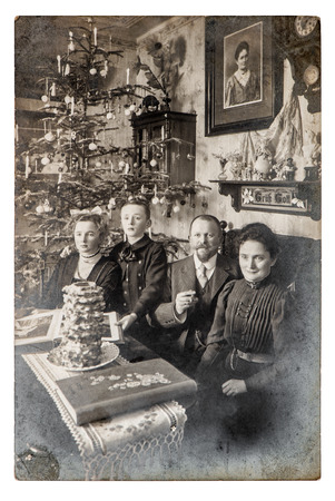 Old family photo parents andchildren. Vintage home interior with Christmas tree