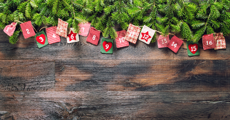Advent calendar with Christmas gifts on dark wooden background