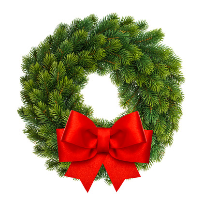 Christmas decoration evergreen wreath with red ribbon bow isolated on white background