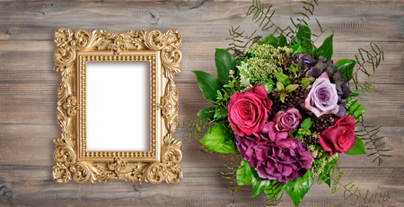 Golden picture frame and rose flowers. Vintage style mockup with space for your picture or text 写真素材