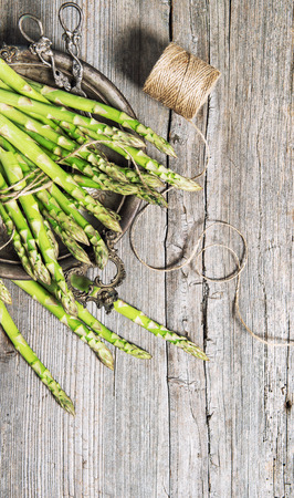 Asparagus on rustic wooden background. Vintage style picture Stock Photo