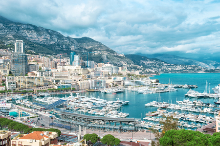 View of Monaco harbor. Luxury yacht in port Hercules. Mediterranean Sea landscape