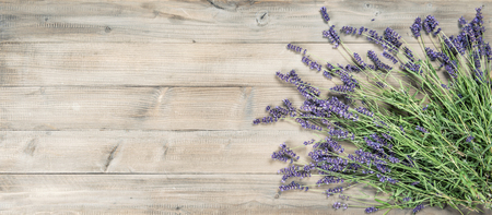 Lavender flowers on rustic wooden background. Vintage style toned picture