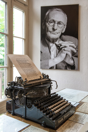 Portrait and original vintage typewriter in Herman Hesse museum in Montagnola, where famous poet and writer 1931–1962 lived