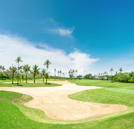 Golf course. Sand trap and palm trees. Bali Indonesia Imagens