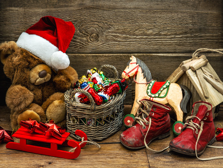 Christmas decoration with vintage toys on wooden background