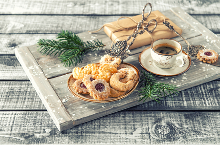 Christmas cookies with coffee and decoration. Vintage toned picture
