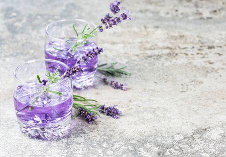 Lavender flower drink. Summer tonik lemonade on grey background