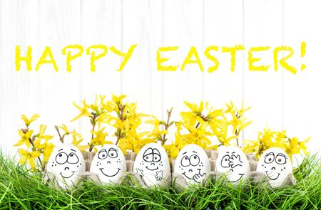 Easter eggs with flowers decoration in green grass Stock Photo