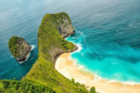 Sea rocks, sand beach and turquoise ocean. Manta Bay, Kelingking Beach, Nusa Penida Island, Bali, Indonesia