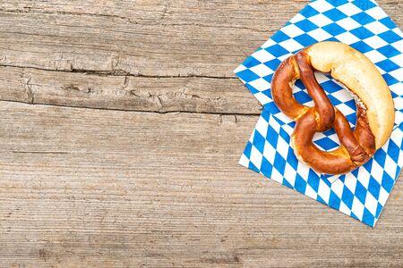 Bavarian bread pretzel on board wooden background