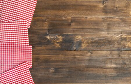 Wooden kitchen table background and chequered tablecloth
