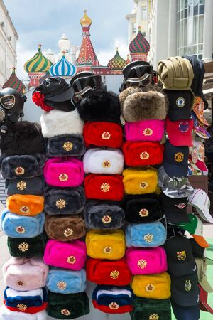 Moscow, Russia - JULY 05, 2019: Russian winter fur hats in street gift shop, popular souvenir from Russia