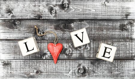 Letter LOVE and wooden red heart on rustic background. Valentines Day banner Фото со стока
