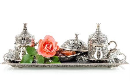 Tea table setting with dates and rose flower decoration