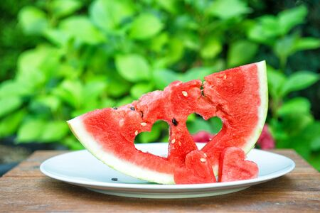 Watermelon hearts on nature outdoors background