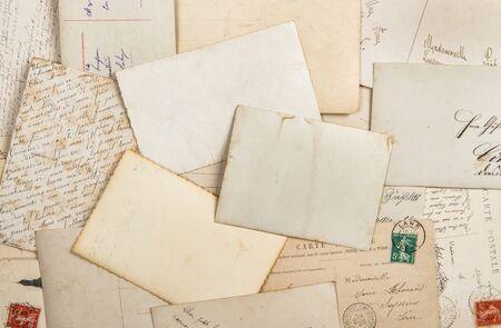 Old photos and vintage postcards. Nostalgic paper background