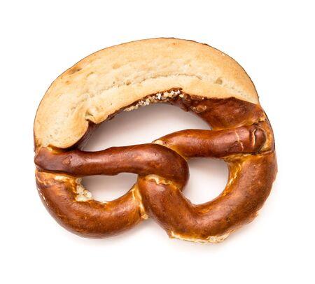 Bavarian salted bread pretzel isolated on white background. Oktoberfest symbol Stock Photo