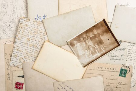 Old photos and vintage postcards. Used paper background