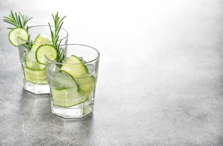 Fresh drink with cucumber and rosemary herb. Cold summer lemonade Stock Photo