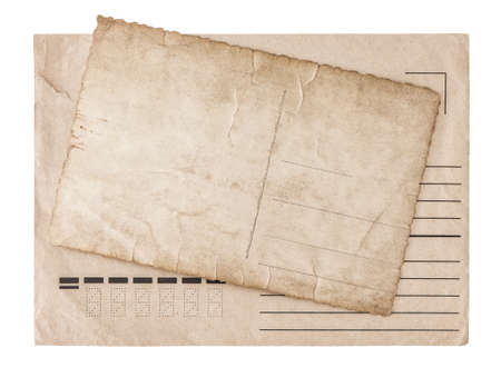 Vintage grungy envelope and used paper postcard isolated on white background
