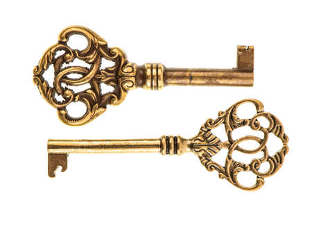 Golden antique keys isolated on white background. vintage accessories