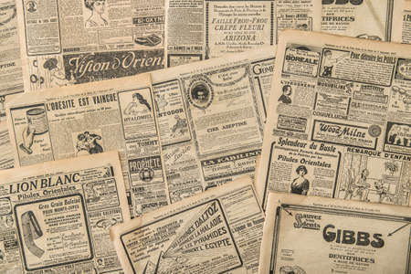 Newspaper pages with antique advertising. Vintage fashion magazine for woman Éditoriale