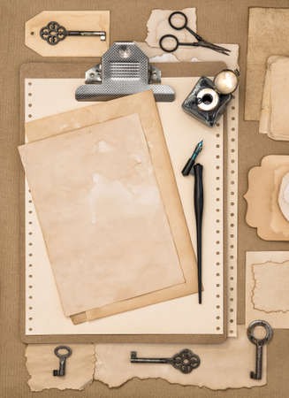 Paper, clipboard and calligraphic writing tools. Vintage style flat lay