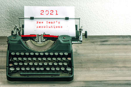 Vintage typewriter with white paper. 2021 New Year's Resolutions