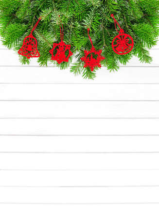 Christmas background with red decoration on white wood texture