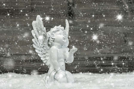 Angel in snow with snowflakes and stars. Christmas decoration