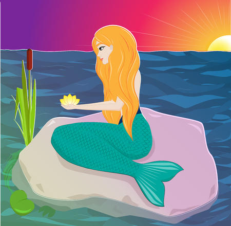 The red-haired mermaid sits on a rock and holds a flower in his hands. Water nymph