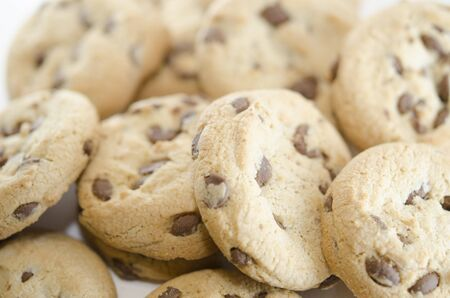 Lots of chocolate chip cookies. Close-up on baking. Delicious homemade dessert or pastry Фото со стока