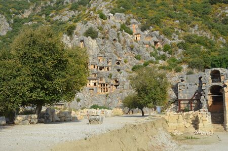 Ancient architecture in Demre. Lycian necropolis with tomb carved in rocks in Mira