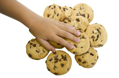 Hand reaches for a cookie with chocolate chips. The restriction of sweet. Healthy diet