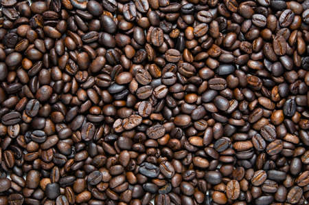 Background of dark roasted coffee beans. Food