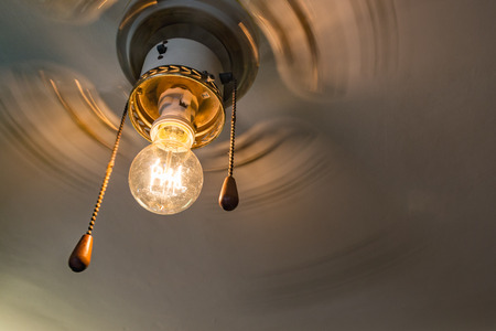 metal filament: Retro fan with Edisons lamp Stock Photo