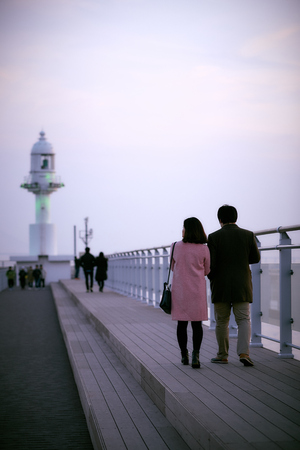 Couple walking to the lighthouse  Wolmie in Incheon