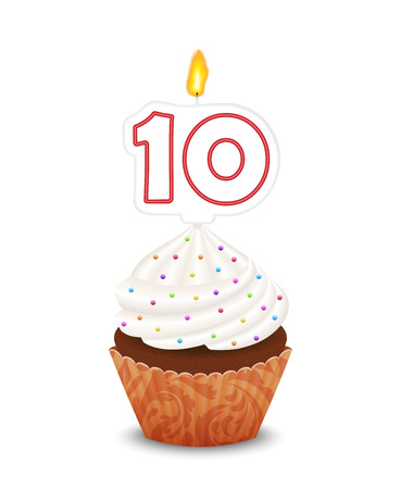 tenth birthday: Birthday cupcake with candle number ten shape