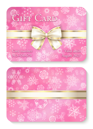 Luxury pink quartz Christmas gift card with white snowflakes in background and cream ribbon as decoration