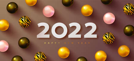 Happy New 2022 Year. Holiday background with white paper numbers 2022 and Realistic black,golden, pink and golden balls with tiger pattern. Realistic 3d sign. Festive design for poster, banners, flyers, card, brochure.