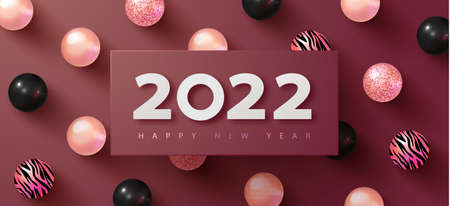 Happy New 2022 Year. Holiday background with white paper numbers 2022 and Realistic black and pink balls with tiger pattern. Realistic 3d sign. Festive design for poster, banners, flyers, card, brochure.