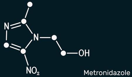 Metronidazole, antiprotozoal medication molecule. It is antibiotic, belonging to the nitroimidazole class of antibiotics. Skeletal chemical formula on the dark blue background. Illustration